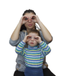 A mother and child pretend their hands are binoculars