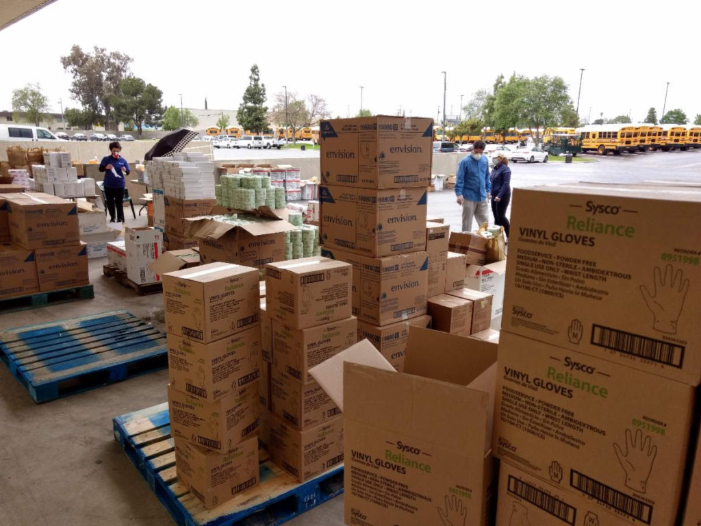 Piles of boxes of gloves sit on palettes at a supply distributions